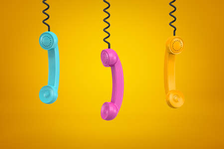 3d rendering of three colorful retro telephone receivers hanging on yellow background Banco de Imagens