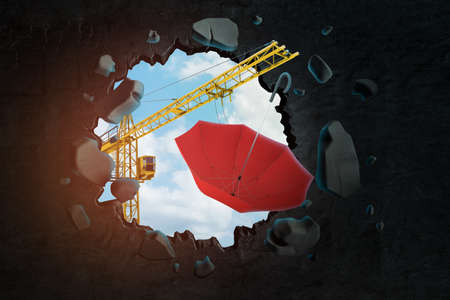 3d rendering of hoisting crane carrying red umbrella and breaking black wall leaving hole in it with blue sky seen through. Banco de Imagens