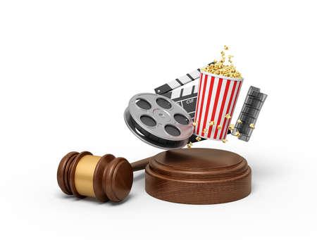3d rendering of film reel, popcorn bucket, and clapperboard suspended in air above sound block with gavel beside. Foto de archivo - 132043645