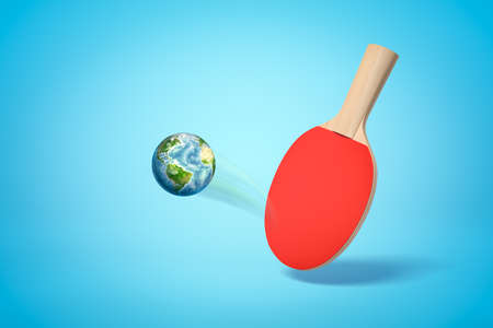 3d rendering of table tennis racket and earth globe as ping pong ball on blue background 写真素材
