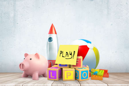 3d close-up rendering of different toys and piggy bank, with yellow note saying Play, on wooden floor.