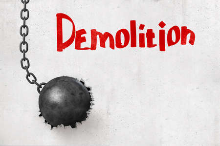 3d rendering of wrecking ball that has broken hole in concrete wall with title Demolition. Foto de archivo
