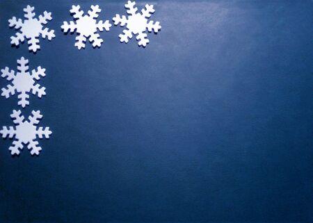 White snowflakes on a classic blue background . Christmas background. Pantone 2020. Festive decoration.