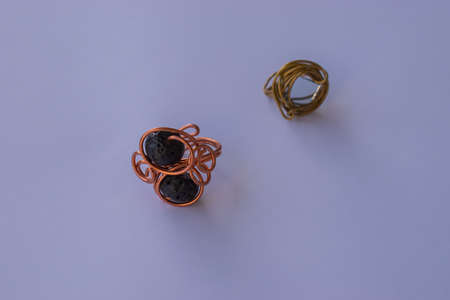 Unique handmade jewelry made of copper wire and colourful stones. Taken in the Golden City of Pforzheim, Germany 版權商用圖片