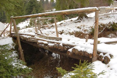 Old snow-clad bridge