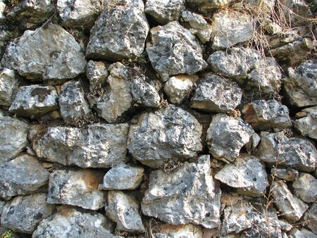 Old wall built by gray stone