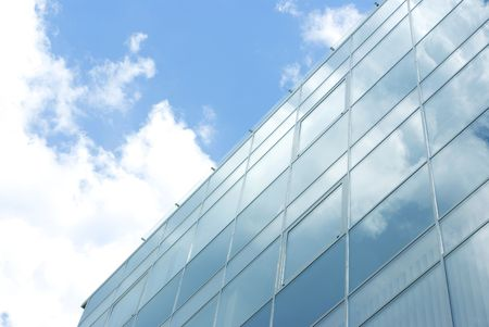 Glass facade on blue sky background Stock Photo