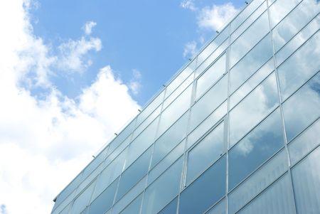 blue facades sky: Glass facade on blue sky background Stock Photo