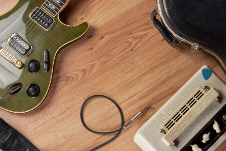 amp: Shot of guitar and amp on a wooden surface