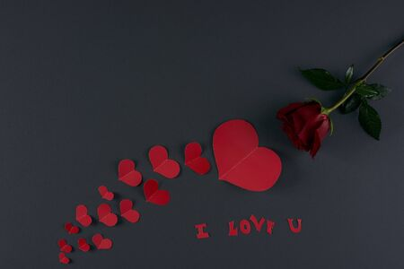 i love u: Inscription I Love U, Red hearts and rose flower on a dark background. Love card concept, Valentines day theme. Shot from above