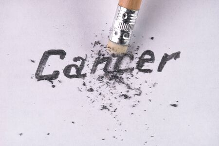 pencil eraser: Cancer word removing with pencil eraser. Healthcare and medicine concept