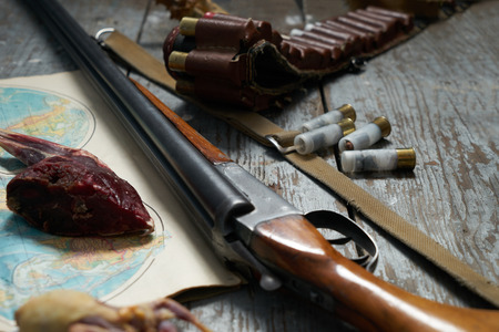 vintage rifle: Hunting equipment on old wooden background Stock Photo