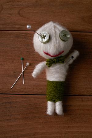 veiw: Cute Little Voodoo Doll with pins.Top veiw Stock Photo