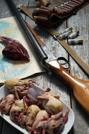 vintage rifle: Hunting equipment on old wooden background.contept