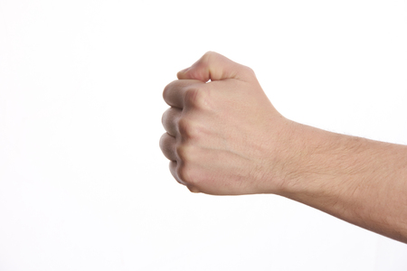 Male clenched fist, isolated on a white background Man hand with a fist.