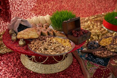Novruz tray with Azerbaijan national desserts against silk scarf background