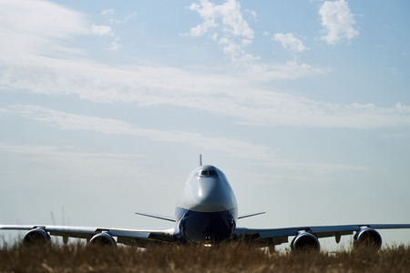 Big cargo aircraft moves on the runway.The cockpit and fuselage close up, Foreground. Stock Photo