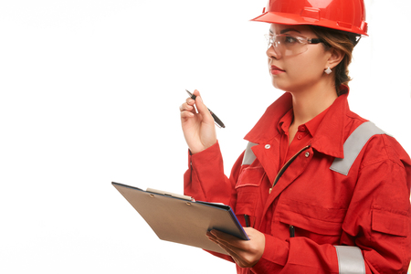protective suit: Woman engineer and construction worker in hard hat and workwear uniform are checking the list on the clipboard isolated on white background with copy space. Close-up portrait