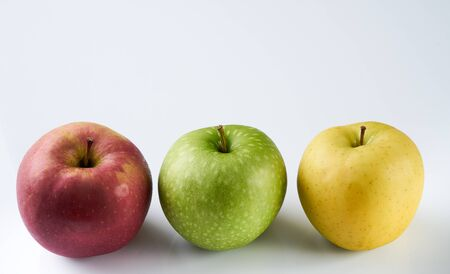 The ripe juicy three apples isolated on white background with copy space. red, green and yellow apple in the form of a traffic light