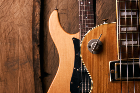 Wooden electric bass guitar and classic electric guitar Stock Photo