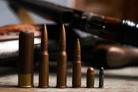 Different type of bullets and shotguns Stok Fotoğraf - 94604165