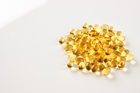 Vitamin Omega-3 fish oil capsules isolated on white background with copy space. Cod liver oil pills, close-up
