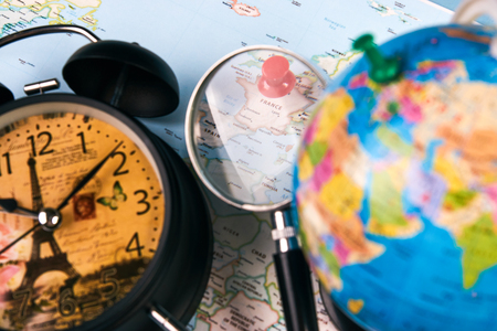 Planing for travel to france paris with worldmap globe magnifying planing for travel to france paris with worldmap globe magnifying glass and alarm clock travel gumiabroncs Image collections