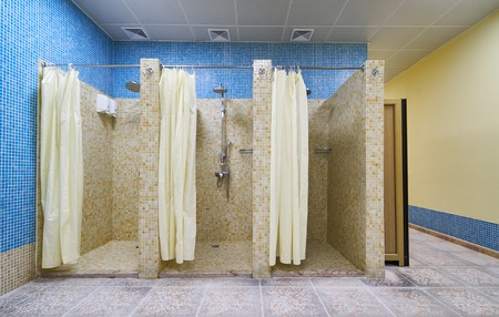 Three Empty Showers in modern Gym Locker Room Foto de archivo