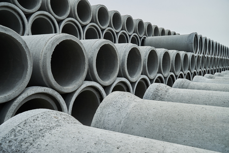 Stacked pipe at concrete factory. Large Concrete Construction Pipes for Underground Water