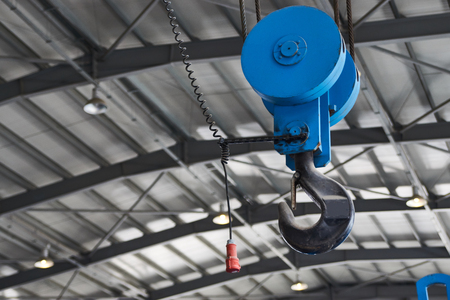 Blue Metallic industrial hook for lifting heavy thing in the factory warehouse