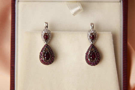 Pair of ruby diamond earrings in jewelry box, close-up. Beautiful luxury brilliant jewelry Zdjęcie Seryjne
