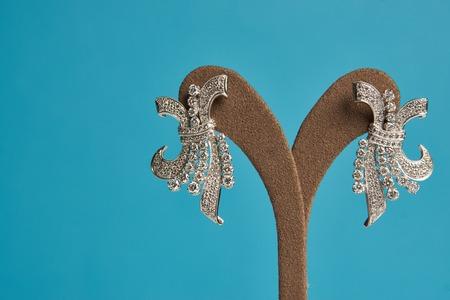 Diamond earrings jewellery, close-up. Beautiful luxury brilliant jewelry