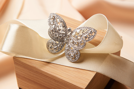 Beautiful butterfly shaped gold diamond ring or brooch. Luxury female jewellery, close-up. Selective focus Banque d'images