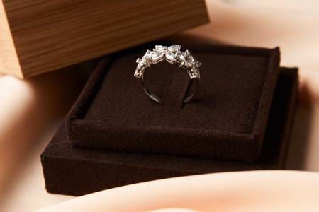 Wedding diamond ring with gift box, close-up. Luxury female jewellery, selective focus Archivio Fotografico