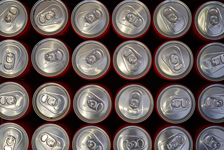 Top view aluminium cans. Beer cans on dark background Foto de archivo