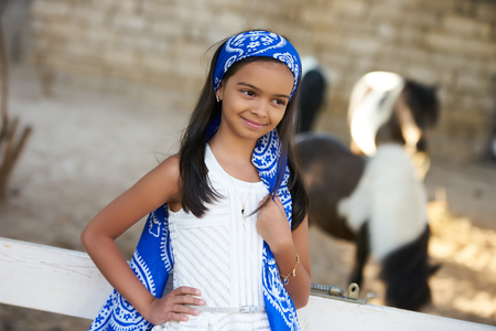 Beautiful young girl and horses. Cute smiling girl with long dark hear