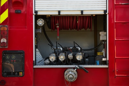 Firefighter truck with firemans cane after a fire, close-up, outdoors Stockfoto - 111203358