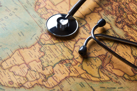 Medical stethoscope over Africa healthcheck. Fever vaccination concept tourism travel care diseases healthy, close-up. Stethoscope on map background with copy space, top view, selective focus. Reklamní fotografie - 126347192