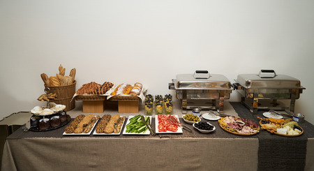 Catering wedding buffet food table on gray wall background with copy space, close-up Banco de Imagens