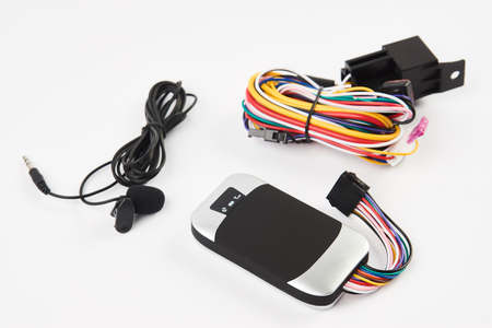 GPS tracker isolated on white. Anti-theft car security system. Car repair service concept Archivio Fotografico