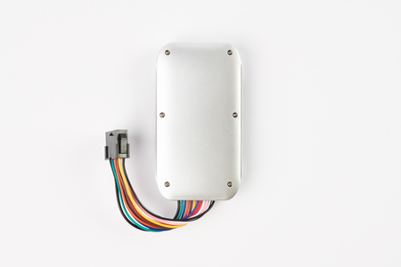 GPS tracker isolated on white. Anti-theft car security system. Car repair service concept 免版税图像