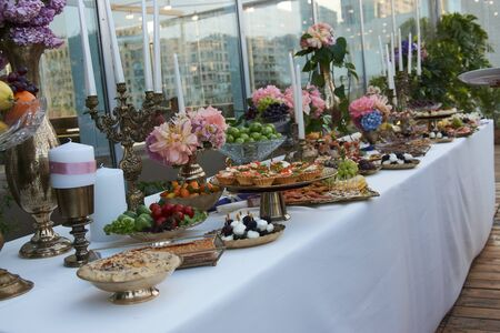 Catering service. Restaurant table with buffet food at wedding event.