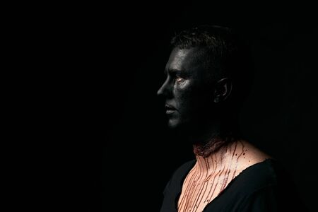 Halloween makeup portrait of a young man with black face and slit throat Stok Fotoğraf