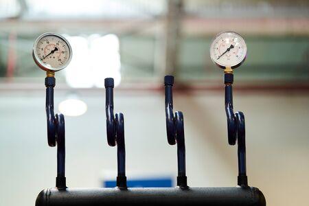 Pressure gauge psi meter on white  with copy space. Pressure meter gauge, close-up