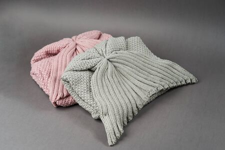Warm woolen comfortable soft socks on gray background with copy space, close-up
