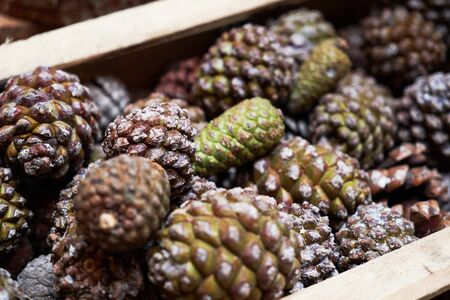 Christmas with Pine cones in wooden box, close-up.