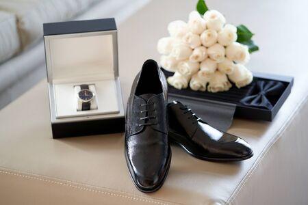 Groom wedding accessories. Groom wedding set with shoes wristwatch bow tie, close-up. Zdjęcie Seryjne