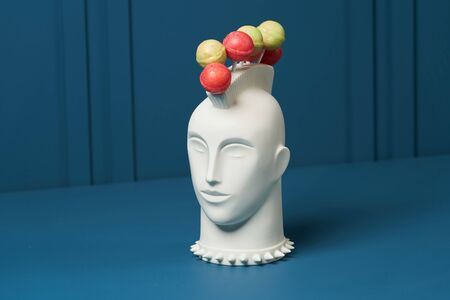 Lollipop holder head on blue  with copy space.
