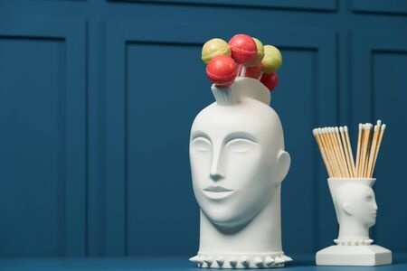 Lollipop holder head on blue Banco de Imagens