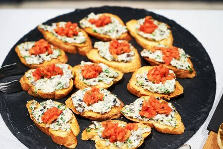 Canapes and appetizers on a table, close up. Catering service buffet tray with canapes and appetizing sandwiches